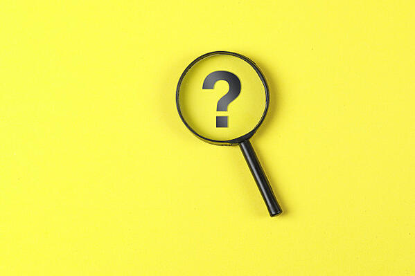 business-financial-concept-with-magnifying-glass-question-mark-yellow-background-flat-lay_176474-6555