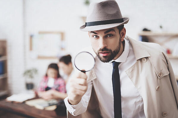 man-is-posing-with-magnifying-glass_94347-746