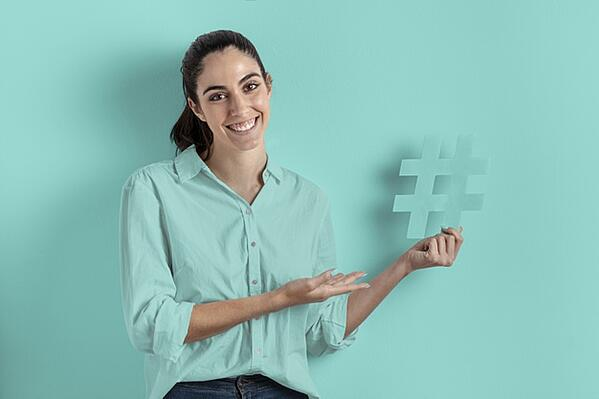 smile-woman-holding-hashtag-sign_23-2148385882 (1)